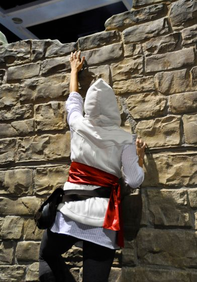 Climbing a wall in Assassin's Creed cosplay